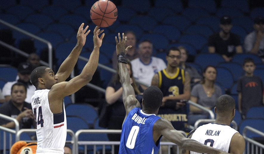 Connecticut guard Rodney Purvis (44) goes up for a shot in front of forward Phillip Nolan, right, and Memphis forward Trashon Burrell (0) during the first half of an NCAA college basketball game in the finals of the American Athletic Conference men's tournament in Orlando, Fla., Sunday, March 13, 2016. (AP Photo/Phelan M. Ebenhack)