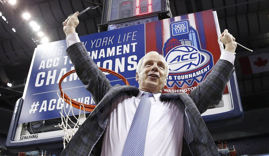 North Carolina head coach Roy Williams holds part of the net after an NCAA college basketball game in the championship of the Atlantic Coast Conference tournament against Virginia, Saturday, March 12, 2016, in Washington. North Carolina won 61-57. (AP Photo/Alex Brandon)
