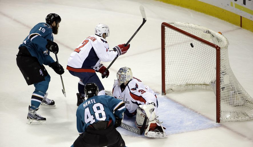 San Jose Sharks' Joe Thornton (19) scores past Washington Capitals goalie Philipp Grubauer (31) during the first period of an NHL hockey game Saturday, March 12, 2016, in San Jose, Calif. (AP Photo/Marcio Jose Sanchez)
