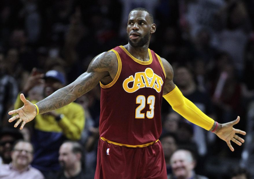 Cleveland Cavaliers forward LeBron James reacts after dunking during the first half of an NBA basketball game against the Los Angeles Clippers in Los Angeles, Sunday, March 13, 2016. (AP Photo/Alex Gallardo)