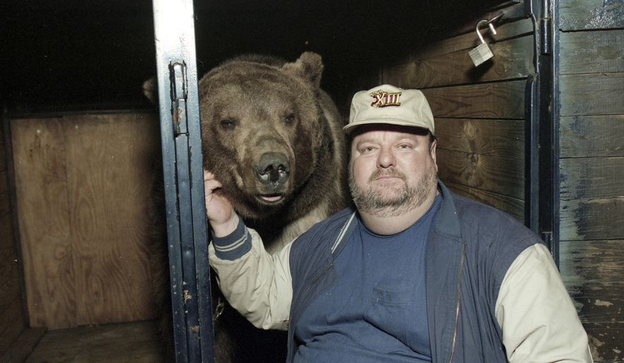 In this 1996 photo, Terrible Ted, the bear, with his owner Richard Walker poses for a photo at the Ponderosa Club in New Hope, Ala. Bear wrestling was, for many years, considered by many to be an entertaining test of one's brute strength. Others, however, criticized it as animal cruelty. (William McCormick/AL.com via AP) MANDATORY CREDIT