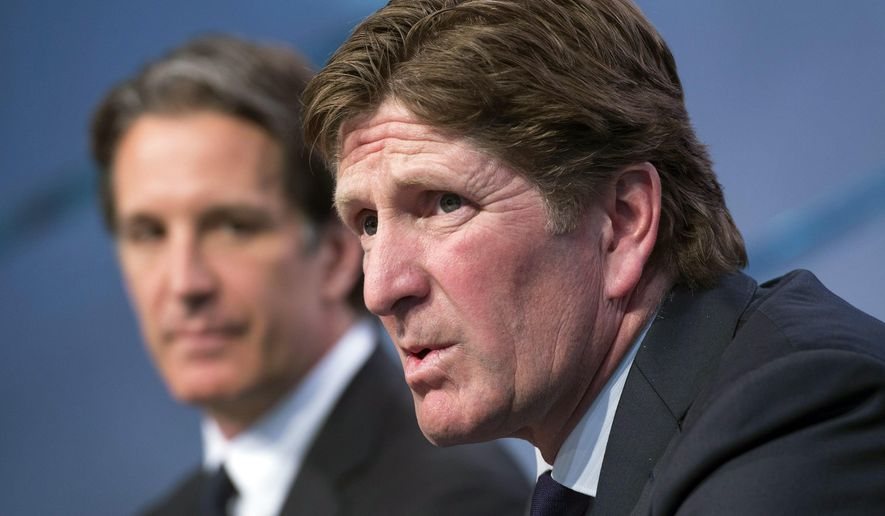 FILE - In this May 21, 2015, file photo, new Toronto Maple Leafs head coach Mike Babcock, right, speaks to reporters with team president Brendan Shanahan during an NHL hockey news conference in Toronto. At their annual March meeting this week, NHL general managers will debate changes to the coach's challenge system that has gotten some calls right but also caused plenty of problems in its first season. (Darren Calabrese/The Canadian Press via AP, File) MANDATORY CREDIT
