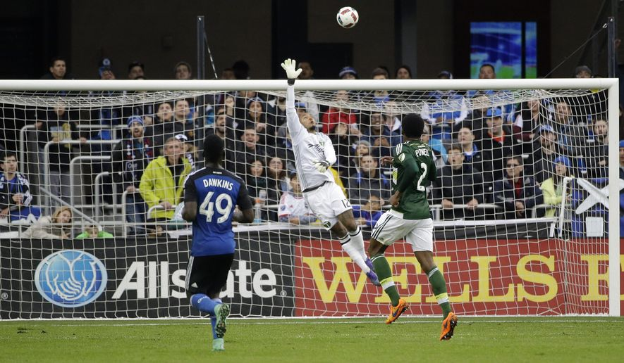 Portland Timbers goalkeeper Adam Larsen Kwarasey (12) is beaten for a goal on a high shot from San Jose Earthquakes forward Quincy Amarikwa (25) during the first half of an MLS soccer match Sunday, March 13, 2016, in San Jose, Calif. (AP Photo/Marcio Jose Sanchez)