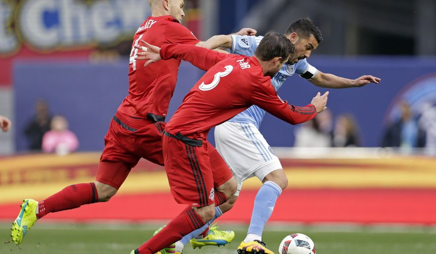 New York City FC forward David Villa (7) battles for control of the ball between Toronto FC defender Drew Moor (3) and Michael Bradley (4) during the first half of an MLS soccer game at Yankee Stadium on Sunday, March 13, 2016, in New York. (AP Photo/Adam Hunger)