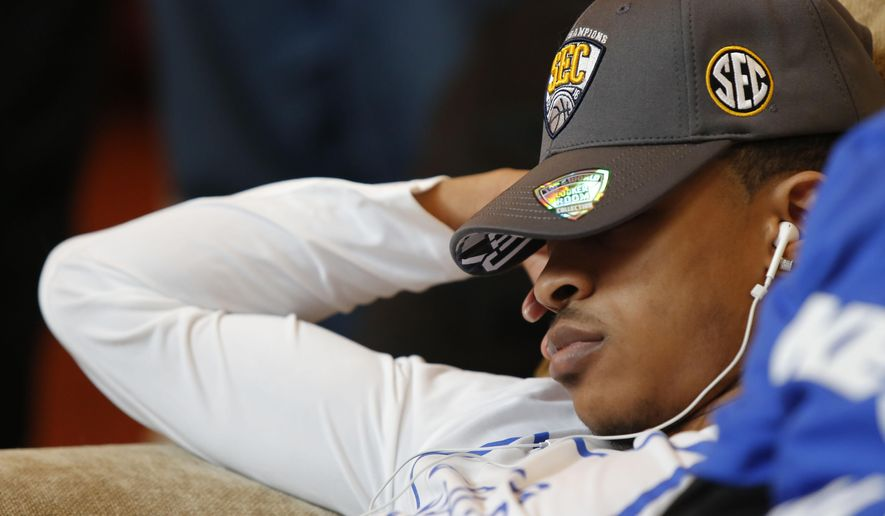 Kentucky's Tyler Ulis sleeps as other members of the men's college basketball team watch the NCAA tournament selection show at the home of head coach John Calipari on Sunday, March 13, 2016, in Lexington, Ky. (AP Photo/James Crisp)