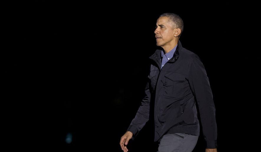 President Barack Obama walks on the South Lawn of the White House in Washington, Saturday, March 12, 2016, upon arrival from a trip to Dallas, Texas.  (AP Photo/Manuel Balce Ceneta)