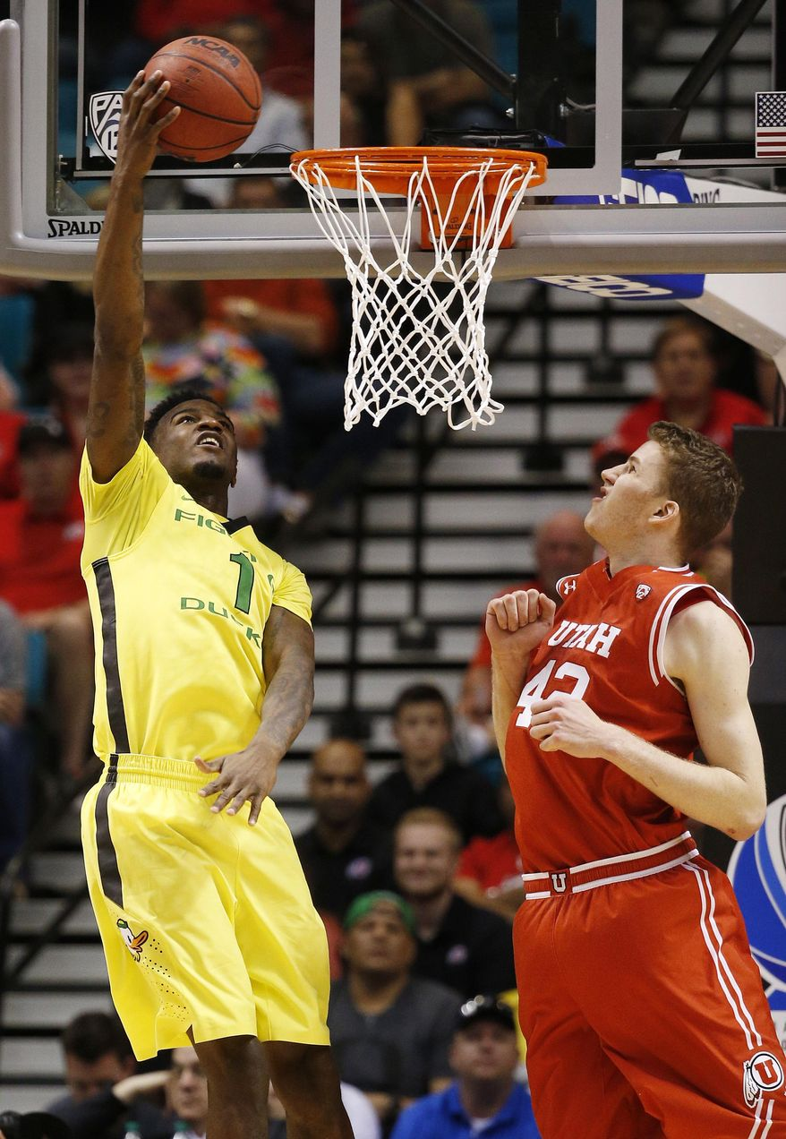 Oregon forward Jordan Bell (1) shoots in front of Utah forward Jakob Poeltl (42) during the first half of an NCAA college basketball game in the championship of the Pac-12 men's tournament Saturday, March 12, 2016, in Las Vegas. (AP Photo/John Locher)
