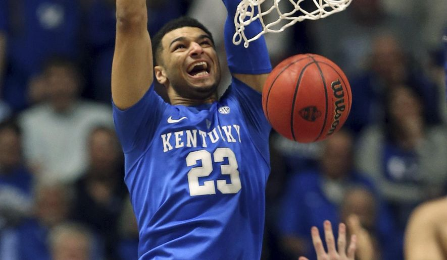 Kentucky's Jamal Murray (23) dunks over Texas A&M's Danuel House, bottom, during the first half of an NCAA college basketball game in the championship of the Southeastern Conference tournament in Nashville, Tenn., Sunday, March 13, 2016. (AP Photo/John Bazemore)