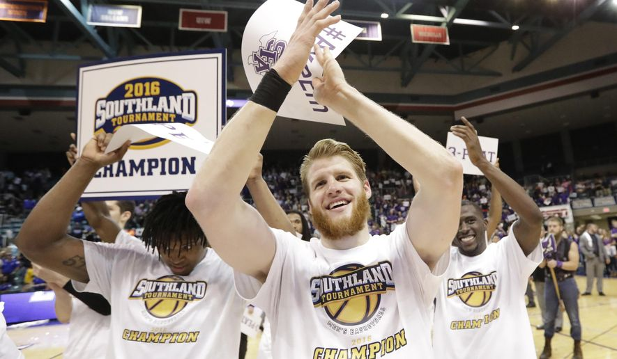 Stephen F. Austin's Thomas Walkup, center, celebrates with teammates after an NCAA college basketball game against Texas A&M-Corpus Christi in the championship of the Southland Conference men's tournament, Saturday, March 12, 2016, in Katy, Texas. Stephen F. Austin won 82-60. (AP Photo/David J. Phillip)