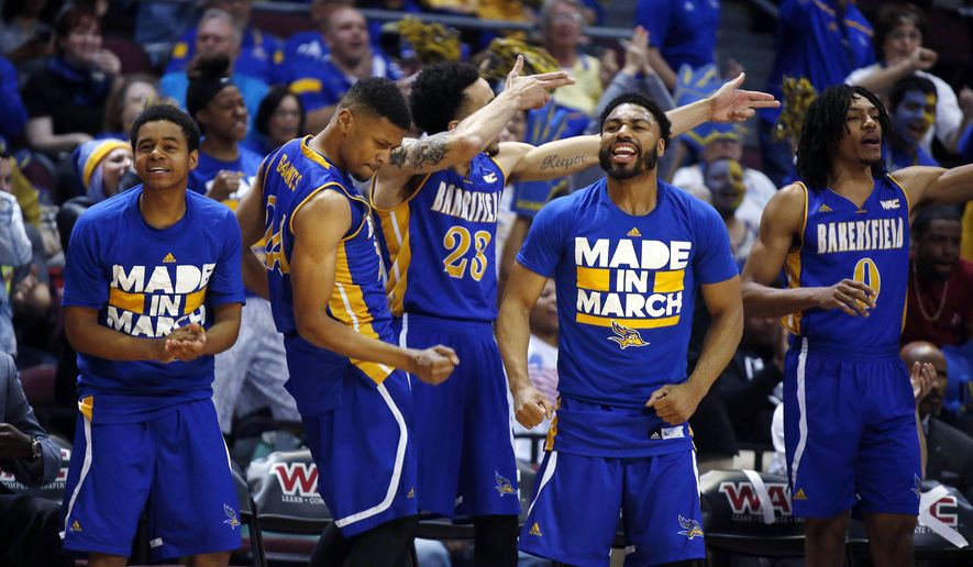 Cal State Bakersfield's bench reacts during the first half of the team's NCAA college basketball game against New Mexico State in the final of the Western Athletic Conference men's tournament Saturday, March 12, 2016, in Las Vegas. (AP Photo/Isaac Brekken)