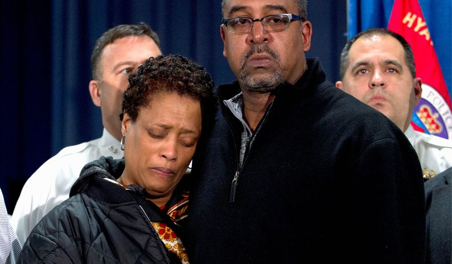 James and Sheila Colson, parents of Prince George's County Police Officer Jacai Colson, attend a news conference at police headquarters in Hyattsville, Md., on March 14, 2016. Colson, a four-year veteran of the force, was fatally shot outside the District III police station by his own colleagues as he responded to an attack on his police station by a gunman with a death wish, their police chief said. (Associated Press) **FILE**