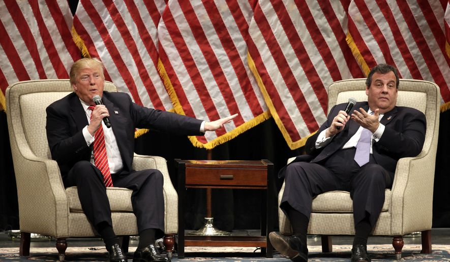 Republican presidential candidate Donald Trump, left, talks with New Jersey Gov. Chris Christie, right, at a rally at Lenoir-Rhyne University in Hickory, N.C., Monday, March 14, 2016. (AP Photo/Chuck Burton)