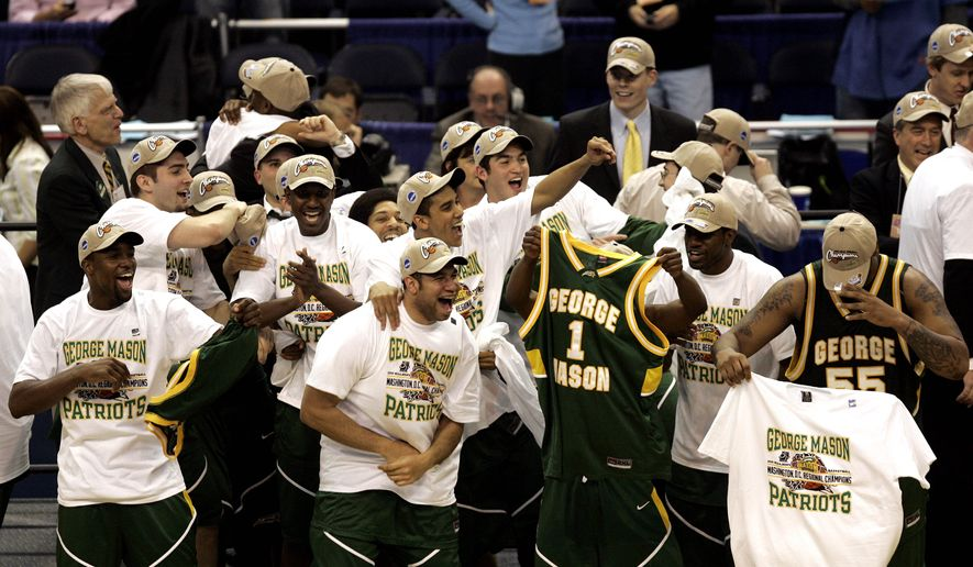 George Mason players celebrate their 86-84 overtime victory over Connecticut during the fourth round game of the NCAA basketball tournament in Washington, Sunday, March 26, 2006. (AP Photo/Susan Walsh)