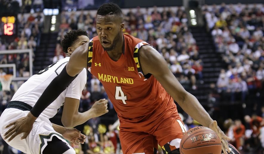 Maryland forward Robert Carter (4) drives past Michigan State forward Deyonta Davis (23) in the first half of an NCAA college basketball game during the semifinals of the Big Ten Conference tournament in Indianapolis, Saturday, March 12, 2016. (AP Photo/AJ Mast)