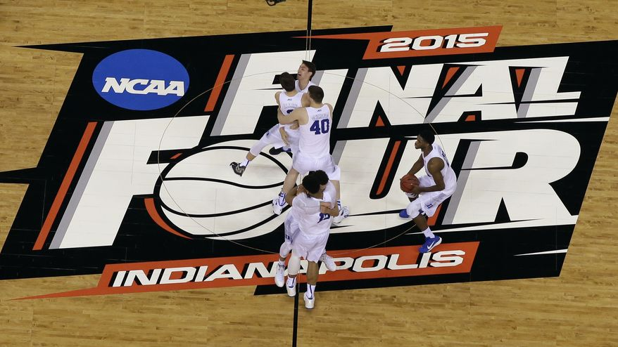 Duke players celebrate after the NCAA Final Four college basketball tournament championship game against Wisconsin  Monday, April 6, 2015, in Indianapolis. Duke won 68-63. (AP Photo/David J. Phillip)