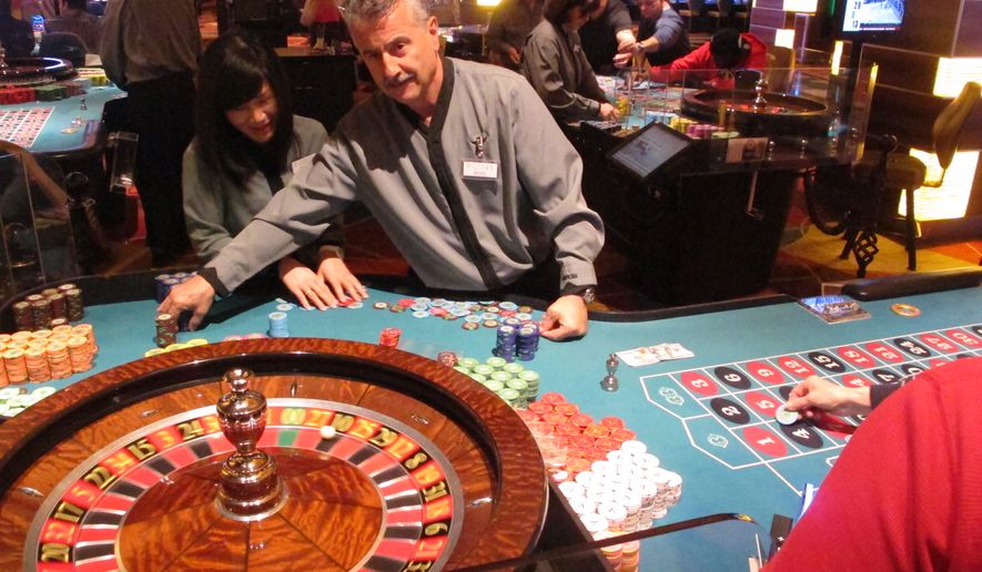 In this March 9, 2016 photo, a dealer runs a game of roulette at the Tropicana casino in Atlantic City, N.J. Figures released Monday March 14, 2016 show Atlantic City's casinos won $204.7 million in February 2016, an increase of 14.7 percent from Feb. 2015. The Tropicana's monthly revenue was up 14.1 percent to over $25 million. (AP Photo/Wayne Parry)