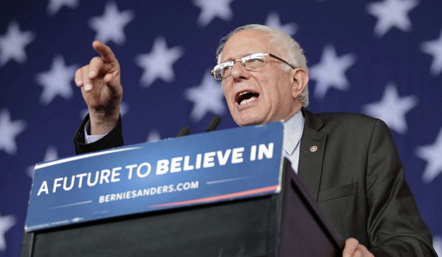 Democratic presidential candidate, Sen. Bernie Sanders, I-Vt., gestures as he speaks during a rally in Charlotte, N.C., Monday, March 14, 2016. (AP Photo/Chuck Burton)