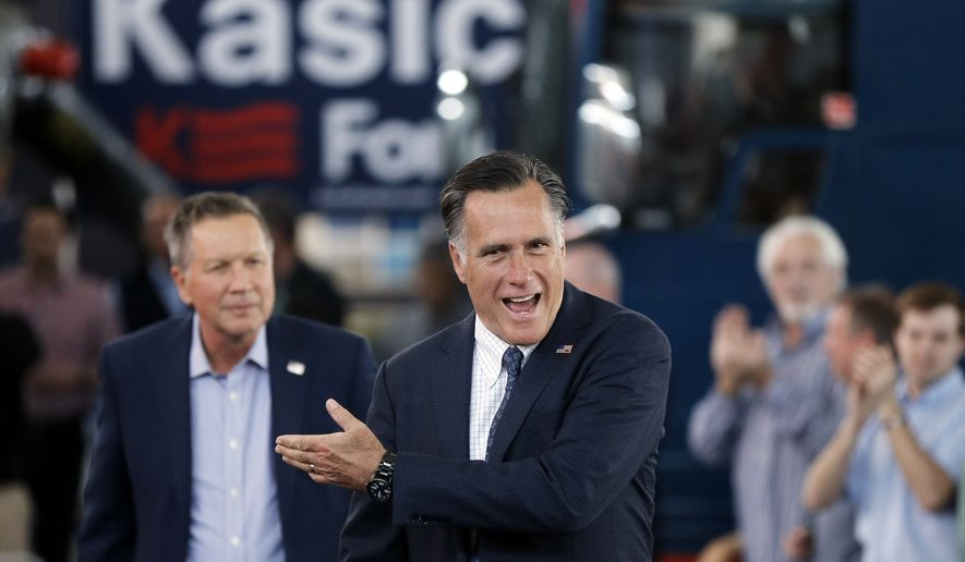 Republican presidential candidate Ohio Gov. John Kasich, left, accompanied by former Republican presidential candidate Mitt Romney arrive for a campaign stop on Monday, March 14, 2016, at the MAPS Air Museum in North Canton, Ohio. (AP Photo/Matt Rourke)