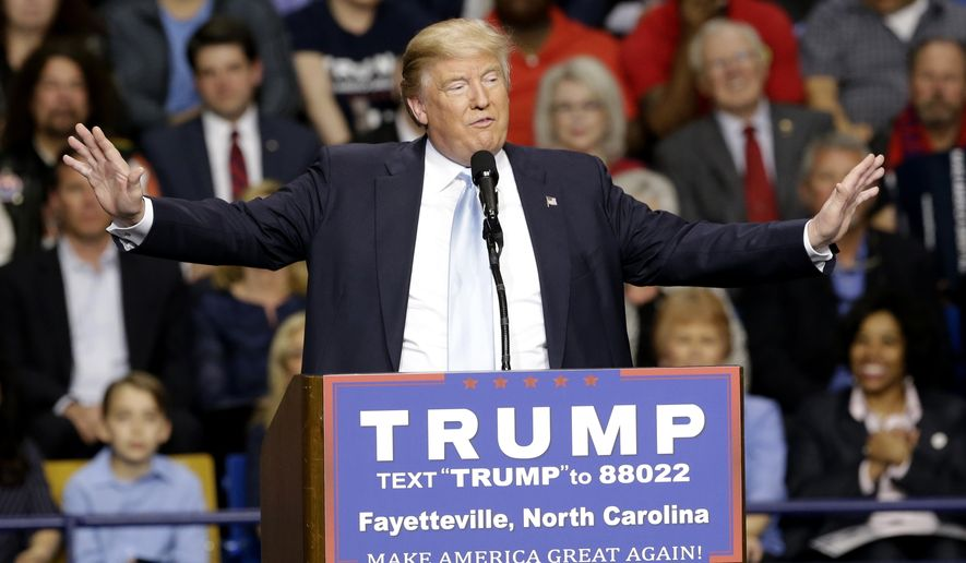 FILE - In this March 9, 2016, file photo, Republican presidential candidate Donald Trump speaks during a campaign rally in Fayetteville, N.C. Authorities in North Carolina say they are looking at Donald Trump's behavior as they continue their probe of a violent altercation at one of his rallies last week. The Cumberland County Sheriff's Office said in a March 14 statement that it's investigators are continuing to look at the rally in Fayetteville, during which a man was hit in the face while being escorted out. (AP Photo/Gerry Broome)