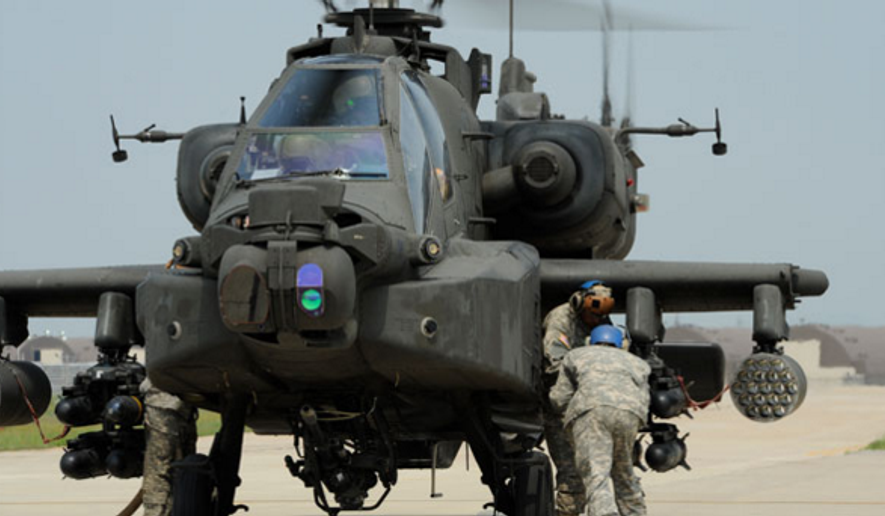 Helicopter crew chiefs load a Hellfire missile onto an AH-64 Apache attack helicopter. Cuba has returned an inert training version of the missile to the U.S. (U.S. Air Force/Tong Duong via Military Times)