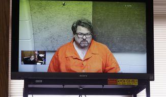 In this Feb. 22, 2016, file photo, Jason Dalton, of Kalamazoo Township, Mich., is arraigned via video in Kalamazoo, Mich. (AP Photo/Carlos Osorio, File)