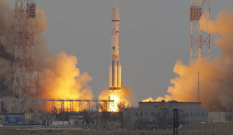 """The Proton-M rocket booster blasts off at the Russian leased Baikonur cosmodrome, Kazakhstan, Monday, March 14, 2016. The Russian rocket carries an orbiter for measuring atmospheric gases of Mars and a Mars lander of the """"ExoMars 2016"""" mission. """"ExoMars 2016"""" is an astrobiology mission by the European Space Agency (ESA) in collaboration with the Russian Federal Space Agency (Roscosmos). (AP Photo/Dmitri Lovetsky)"""