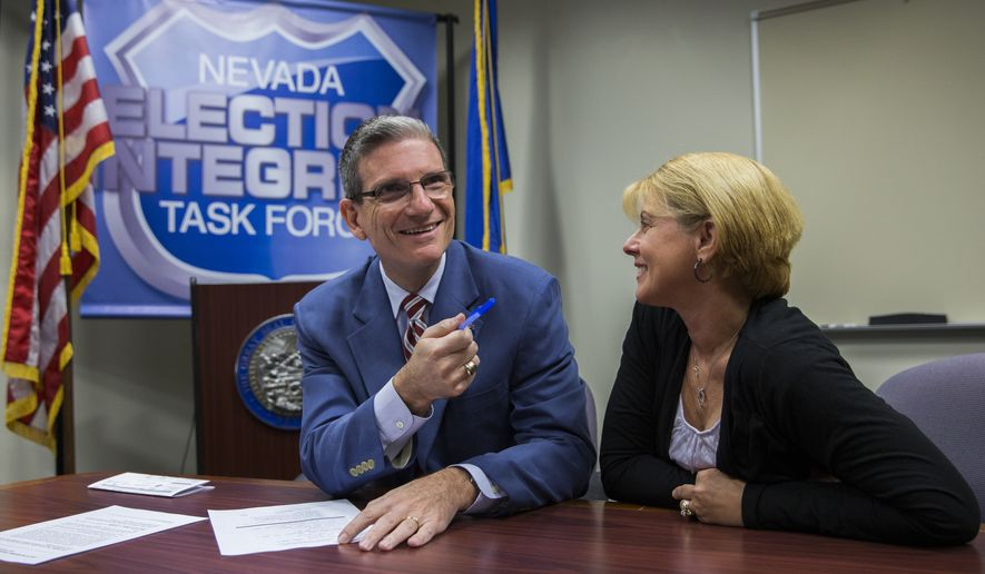 """U.S. Rep. Joe Heck, R-Nev., with his wife Lisa, files to run for the Senate seat of outgoing U.S. Senator Harry Reid at the Grant Sawyer Building Monday, March 14, 2016 in Las Vegas. """"All in all, people just want to know you have their concerns in mind,"""" said Heck. (Benjamin Hager/Las Vegas Review-Journal via AP)"""