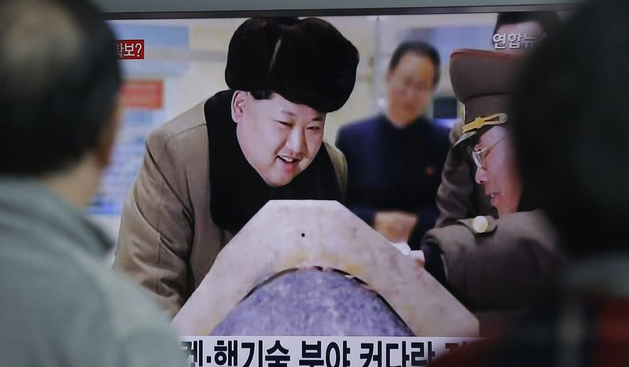 """People watch a TV screen showing North Korean leader Kim Jong Un during a news program, at Seoul Railway Station in Seoul, South Korea, Tuesday, March 15, 2016. North Korean leader Kim has warned of impending tests of a nuclear warhead explosion and ballistic missiles capable of carrying atomic warheads, state media reported Tuesday, in an escalation of threats against Seoul and Washington. The screen reads """"Nuclear technology."""" (AP Photo/Ahn Young-joon)"""