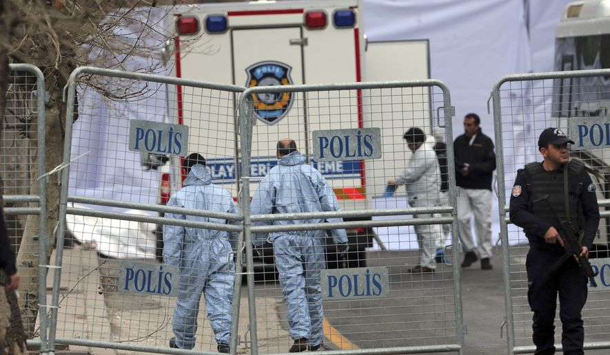 Security and forensic officials work at the site of Sunday's explosion in the busy center of Turkish capital, Ankara Monday, March 14, 2016. The explosion is believed to have been caused by a car bomb that went off close to bus stops. (AP Photo/Burhan Ozbilici)
