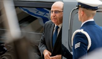 Israel's Minister of Defense Moshe Ya'alon arrives to be greeted by Secretary of Defense Ash Carter during a honor cordon at the Pentagon, in Arlington, Monday, March 14, 2016. (AP Photo/Andrew Harnik)