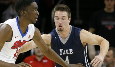 In this Nov. 22, 2015, file photo, Yale's Jack Montague, right, defends against SMU guard Shake Milton during an NCAA college basketball game in Dallas. An attorney for former Yale basketball captain Jack Montague says the player was expelled over a sexual assault allegation and plans to sue the school. Attorney Max Stern issued a statement Monday, March 14, 2016, saying Montague had a consensual relationship with the woman. (AP Photo/Tony Gutierrez, File)