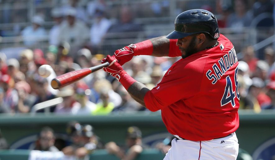 Boston Red Sox's Pablo Sandoval connects for a solo home run off a pitch from Pittsburgh Pirates' Ryan Vogelsong (14) in the second inning of a interleague spring training baseball game, Monday, March 14, 2016, in Fort Myers , Fla. (AP Photo/Tony Gutierrez)