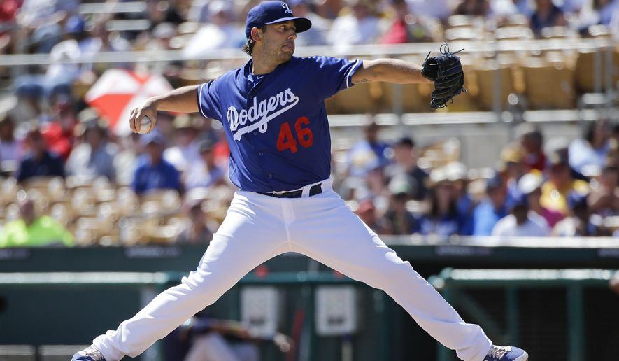 Los Angeles Dodgers starting pitcher Mike Bolsinger throws against the Milwaukee Brewers during the first inning of a spring training baseball game, Monday, March 14, 2016, in Phoenix. (AP Photo/Jae C. Hong)