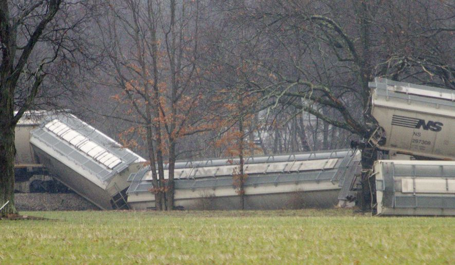 Twenty-three cars of a Great Lakes Central Railroad train derailed Sunday, March 13, 2016, west of Oak Grove Road just north of the Armond Road crossing in Howell Township.  An official says a broken section of track is responsible for a freight-train derailment. (Gillis Benedict/Livingston Daily Press & Argus via AP)