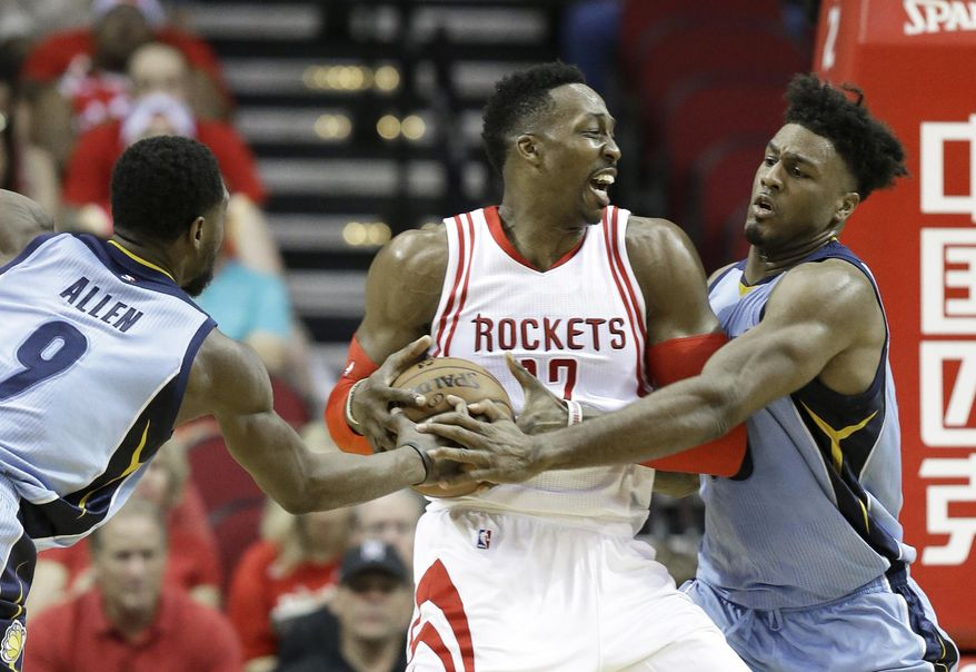 Houston Rockets' Dwight Howard (12) is guarded by Memphis Grizzlies Tony Allen (9) and Alex Stepheson in the first half of an NBA basketball game Monday, March 14, 2016, in Houston. (AP Photo/Pat Sullivan)