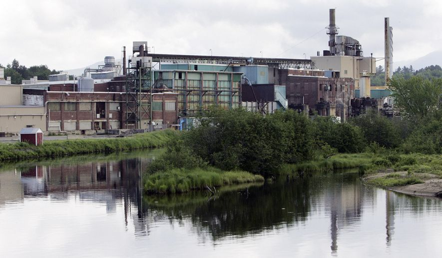 REPLACES INCORRECT CAPTION - FILE - In this Tuesday June 17, 2008 file photo, the closed and shut down paper mill is seen in Groveton, N.H. The mill was the heart of this town and its closing left an uncertain future for the town. On Saturday March 12, 2016 the town voted to spend $400,000 to make infrastructure improvements to the land, in the hope that businesses will locate there. (AP Photo/Jim Cole, File)