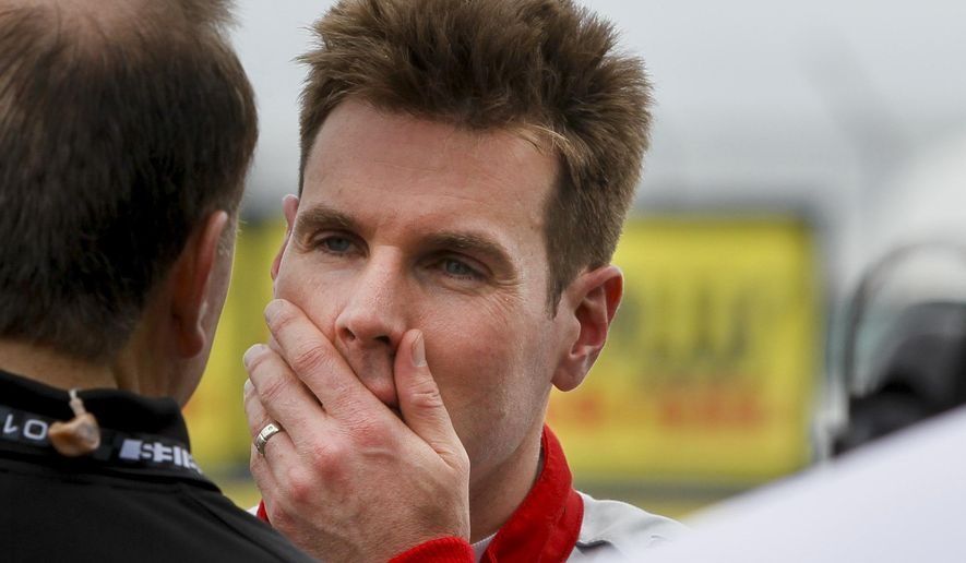 IndyCar driver Will Power, who struggled early and hit a wall during a practice session, talks while in the pits on opening day of the IndyCar, Firestone Grand Prix of St. Petersburg on Friday, March 11, 2016, in St. Petersburg, Fla (Dirk Shadd/The Tampa Bay Times via AP)  TAMPA OUT; CITRUS COUNTY OUT; PORT CHARLOTTE OUT; BROOKSVILLE HERNANDO TODAY OUT