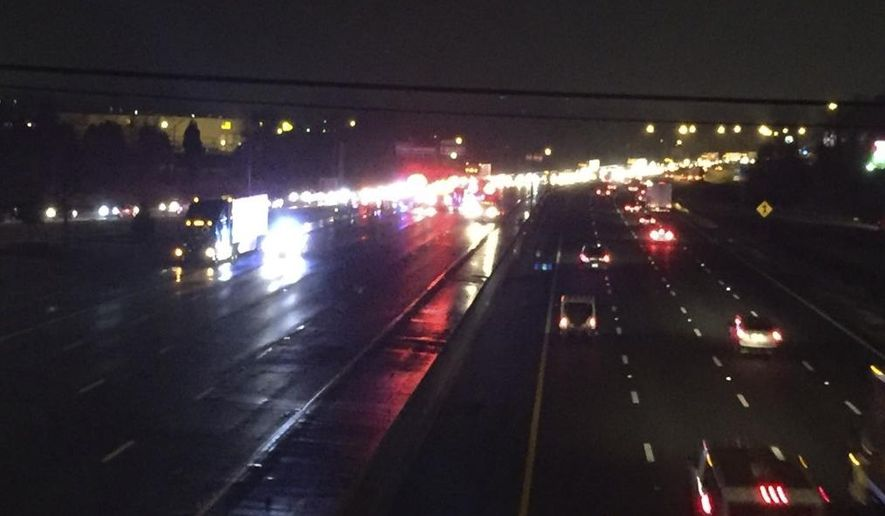 This photo provided by ABC11 shows traffic backing up on westbound Interstate 40 from the view of Exit 154 after multiple vehicle accidents Sunday, March 13, 2016, in central North Carolina. Authorities say dozens of vehicles were involved in a series of wrecks that injured over a dozen people and temporarily shut down part of Interstate 40. (Tim Pulliam/ABC11 via AP) MANDATORY CREDIT