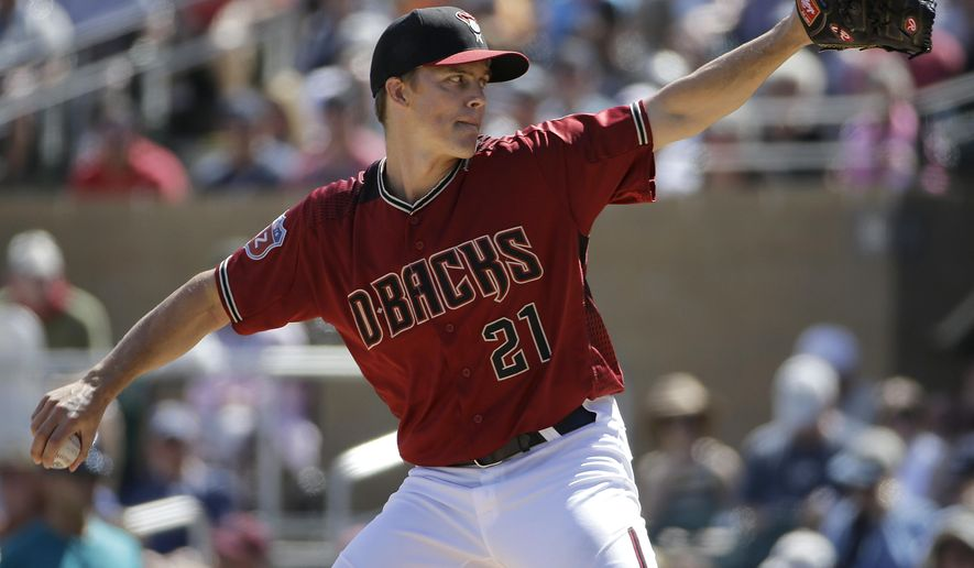 Arizona Diamondbacks' Zack Greinke (21) throws against the Seattle Mariners during the second inning of a spring training baseball game in Scottsdale, Ariz., Monday, March 14, 2016. (AP Photo/Jeff Chiu)