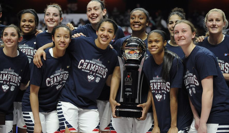 FILE- In this March 7, 2016, file photo, Connecticut players pose with the championship trophy at the end of a NCAA college basketball game in the American Athletic Conference tournament finals against South Florida at Mohegan Sun Arena in Uncasville, Conn. UConn was the top overall seed in the women's NCAA Tournament that was revealed Monday, March 14, 2016. (AP Photo/Jessica Hill, File)