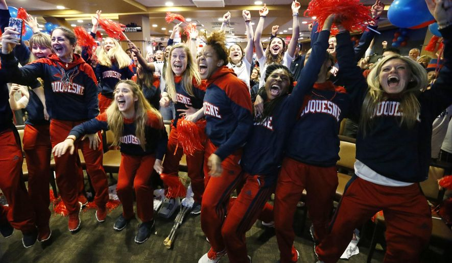 Members of the Duquesne basketball team celebrate as they hear their first-ever berth in the NCAA women's college basketball tournament on Monday, March 14, 2016, in Pittsburgh. Duquesne will play Seton Hall in their first-ever NCAA tournament invitation. (AP Photo/Keith Srakocic)