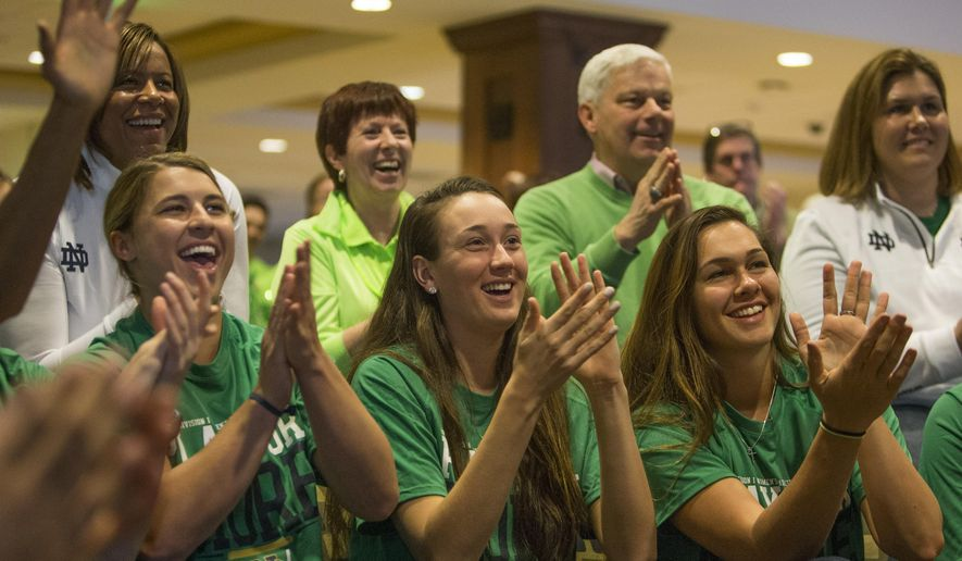 Notre Dame women's basketball players Hannah Huffman, left, Michaela Mabrey, center, and Kathryn Westbeld react as their placement as a No. 1 seed in the NCAA tournament is announced during the ESPN selection show on Monday, March 14, 2016, in South Bend, Ind. (Robert Franklin/South Bend Tribune via AP) MANDATORY CREDIT