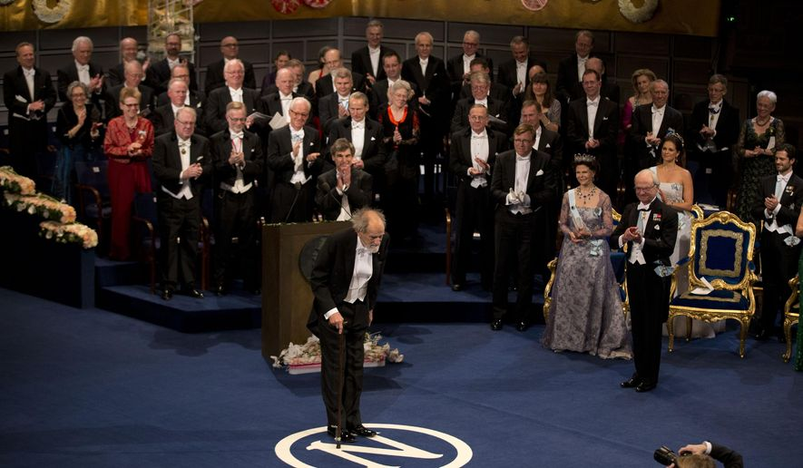 """FILE - In this Monday Dec. 10, 2012, file photo, the 2012 Nobel Prize Laureate for Economic Sciences Lloyd S. Shapley, center, from the U.S., bows after receiving his Nobel Prize from Sweden's King Carl XVI Gustaf, at right, during the Nobel Prize award ceremony at the Stockholm Concert Hall in Stockholm. Shapley, a former professor emeritus at University of California Los Angeles, and an expert on strategic decision-making called """"game theory"""" who shared a Nobel Prize in economics, died Sunday, March 13, 2016, in Arizona, according to the RAND Corp., where he was a longtime researcher. He was 92. (AP Photo/Matt Dunham, File)"""