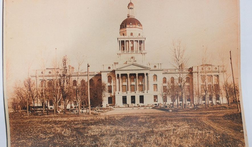 A photo from the late 19th century shows the second state Capitol building, in Lincoln, Neb. Remains of Nebraska's second Lincoln Capitol have surfaced as workers have excavated dirt in the building's northwest courtyard for the installation of new fountains. (Mischa Lopiano/The Journal-Star via AP) LOCAL TELEVISION OUT; KOLN-TV OUT; KGIN-TV OUT; KLKN-TV OUT; MANDATORY CREDIT