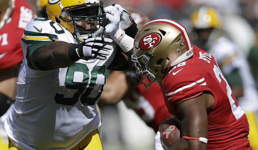 FILE - In this Oct. 4, 2015, file photo, Green Bay Packers nose tackle B.J. Raji (90) reaches for San Francisco 49ers running back Carlos Hyde during the first half of an NFL football game in Santa Clara, Calif. Defensive tackle B.J. Raji says he is taking a hiatus from the NFL and will not play in 2016 following seven seasons with the Green Bay Packers. Raji said Monday, March 14, 2016, in a statement that he made the decision after hours of conversation with family members and mentors. (AP Photo/Ben Margot, File)