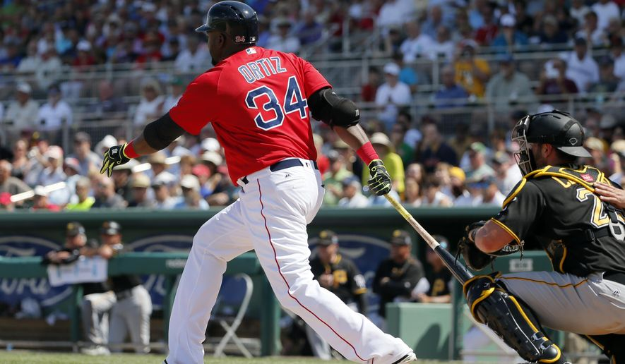 Boston Red Sox's David Ortiz (34) follows through on a ground-out with the bases loaded as Pittsburgh Pirates catcher Francisco Cervelli watches in the fifth inning of an interleague spring training baseball game, Monday, March 14, 2016, in Fort Myers, Fla. (AP Photo/Tony Gutierrez)