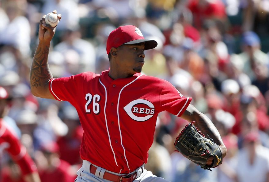 Cincinnati Reds' Raisel Iglesias throws a pitch against the Los Angeles Angels during the first inning of a spring training baseball game Monday, March 14, 2016, in Tempe, Ariz. (AP Photo/Ross D. Franklin)