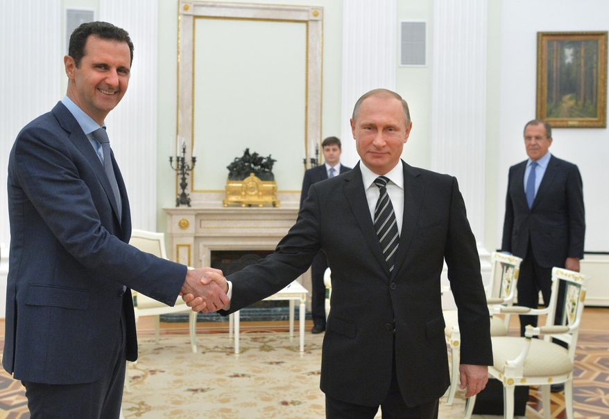 In this file photo taken on Tuesday, Oct. 20, 2015, Russian President Vladimir Putin, center, shakes hand with Syrian President Bashar Assad as Russian Foreign Minister Sergey Lavrov, right, looks on in the Kremlin in Moscow, Russia. (Alexei Druzhinin, Sputnik,  Kremlin Pool Photo via AP, File)