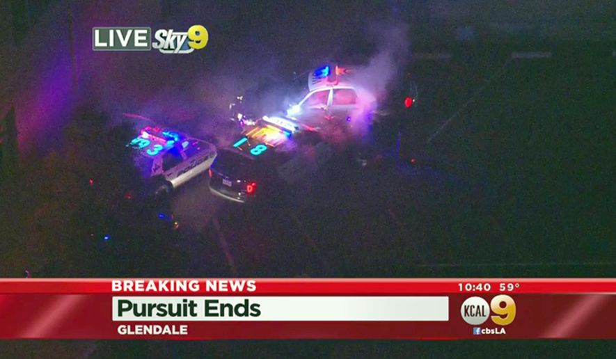 In this March 13, 2016 still image from video provided by KCBS-TV/KCAL9, West Covina, Calif., police officers rammed a stolen patrol car, top, and then shot and killed the suspect after an hour-long chase across Southern California freeways that ended with the dramatic collision in an alley in Glendale, Calif. The driver hit speeds topping 100 mph during the pursuit that was broadcast live on news stations Sunday night.(KCBS-TV/KCAL9 via AP)