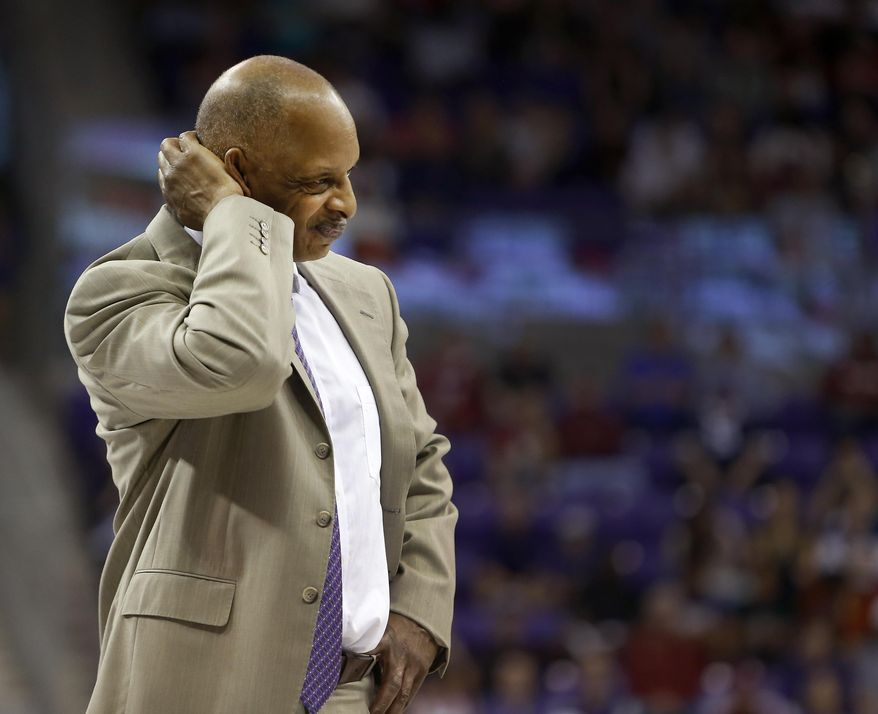FILE - In this March 5, 2016, file photo, TCU head coach Trent Johnson scratches his head during the second half of an NCAA college basketball game against Oklahoma in Fort Worth, Texas. Trent Johnson was fired Monday, March 14, 2016, as TCU's basketball coach after the Horned Frogs won only eight Big 12 Conference games in his four seasons. (Brad Loper/Star-Telegram via AP, File)